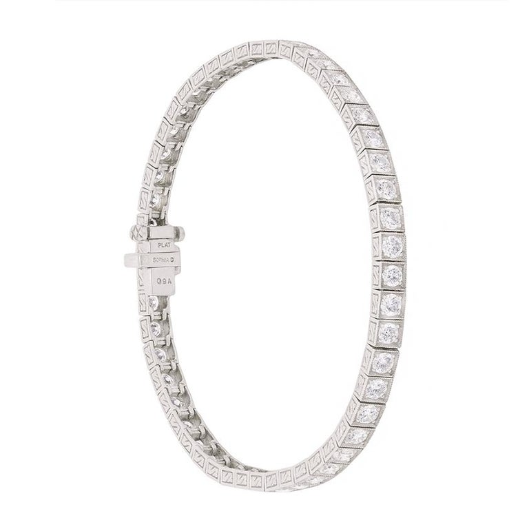 This beautiful Sophia D Tennis Bracelet boasts a total weight of 4.01 carats worth of round brilliant diamonds. These are set within an elegant platinum band, and delicately detailed with millegrain patterning around each individual diamond.  The
