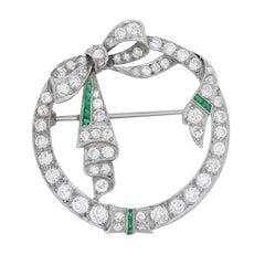 Art Deco Diamond and Emerald Circle Brooch, circa 1920s
