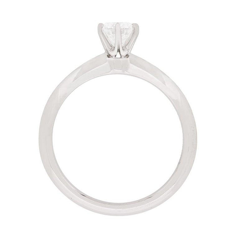 This Tiffany & Co engagement is a high popular design. The diamond in the centre weighs 0.40 carat and is of the highest quality. Graded, with a Tiffany & Co certificate as E in colour and VS1 in clarity, it truly does shine. It has been beautifully
