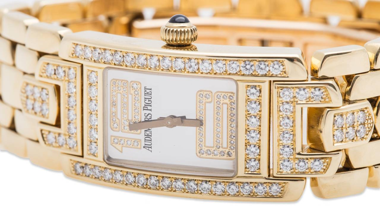 Stunning 18K yellow gold and diamond Audemars Piguet quartz watch. Slightly curved case contours comfortably to the wrist. Full diamond bezel with a total of 46 diamonds. First links at 12:00 & 6:00 set with 20 diamonds each. Mirrored dial with