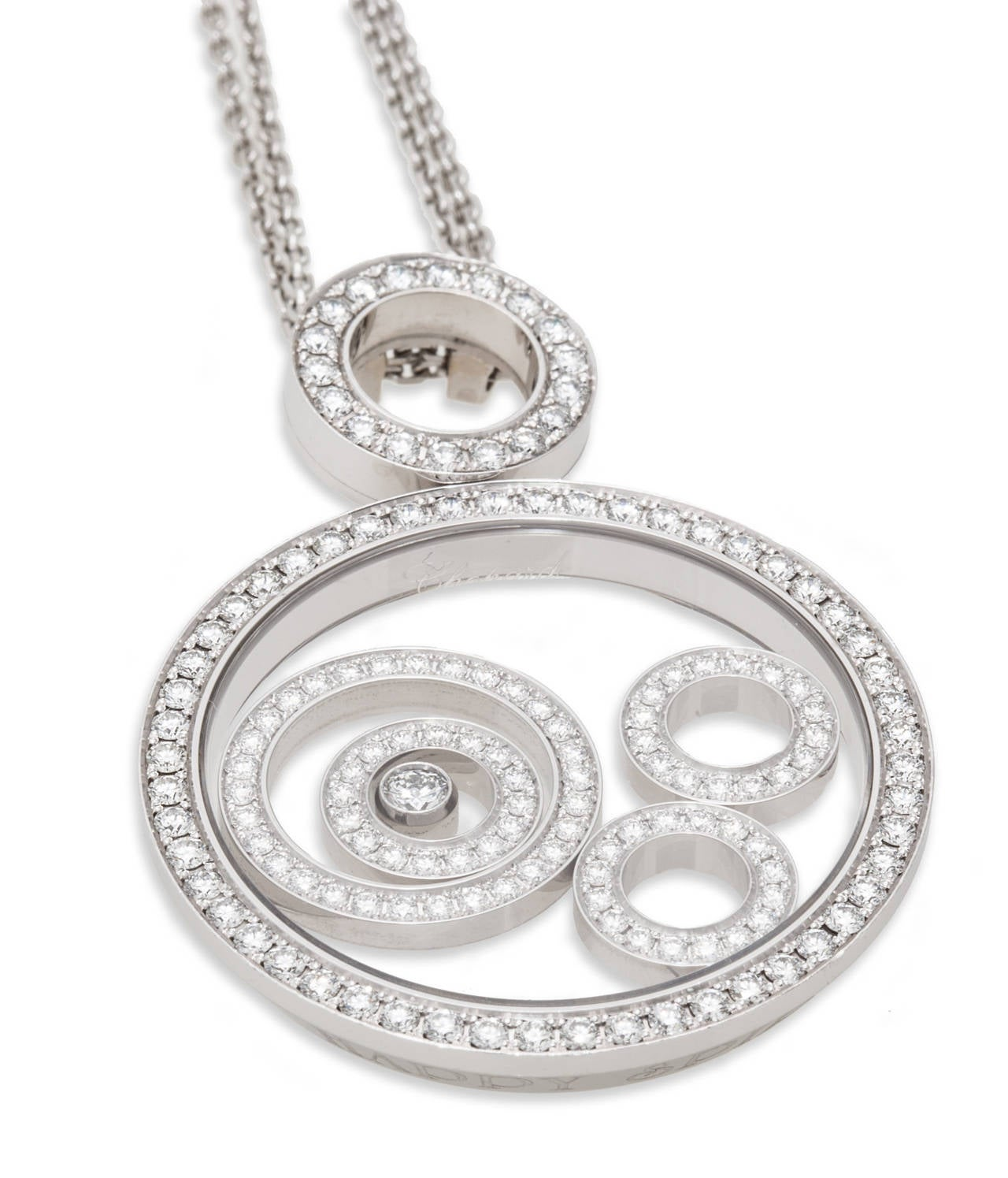 """Chopard Happy Spirit Pendant with diamond bezel and three free moving diamond set circles, the larger of the three encircles another free moving diamond set circle with a free moving diamond in the center. On 24""""/ 61cm 18K White Gold Chopard Chain."""