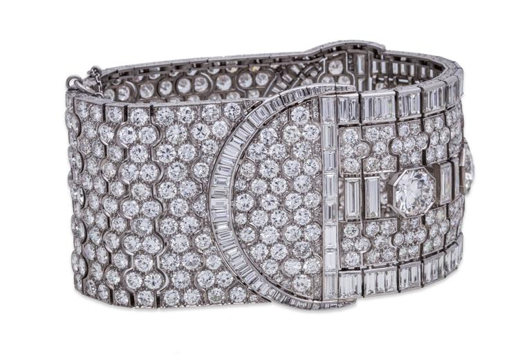 Art Deco Diamond Choker in Platinum, with 100.00ct Total Diamond Weight. Three center stone diamonds are approximately 3.00ct each. Piece can be worn as a choker or ankle cuff. Secured by a black fabric, platinum, and diamond clasp. Dimensions: L