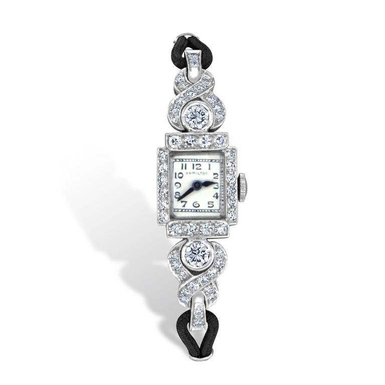 This dignified Hamilton diamond wristwatch from the mid 1900's features 2-Old European cut diamonds having VS2 clarity and G color, and 34-single cut diamonds weighing 2.32 carats total, having VS2 to SI1 clarity and F color.  This platinum watch