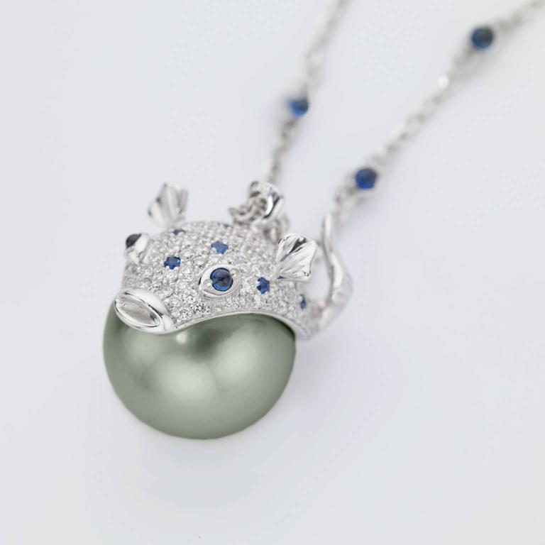 Pendant/Necklace Puffer Fish White Diamond Blue Sapphire Tahiti Pearl 18Kt Gold  With a spherical Tahiti Pearl I created a pendant inspired by the sea world, in particular this is a Puffer fish. The portion in gold is covered by many white diamonds