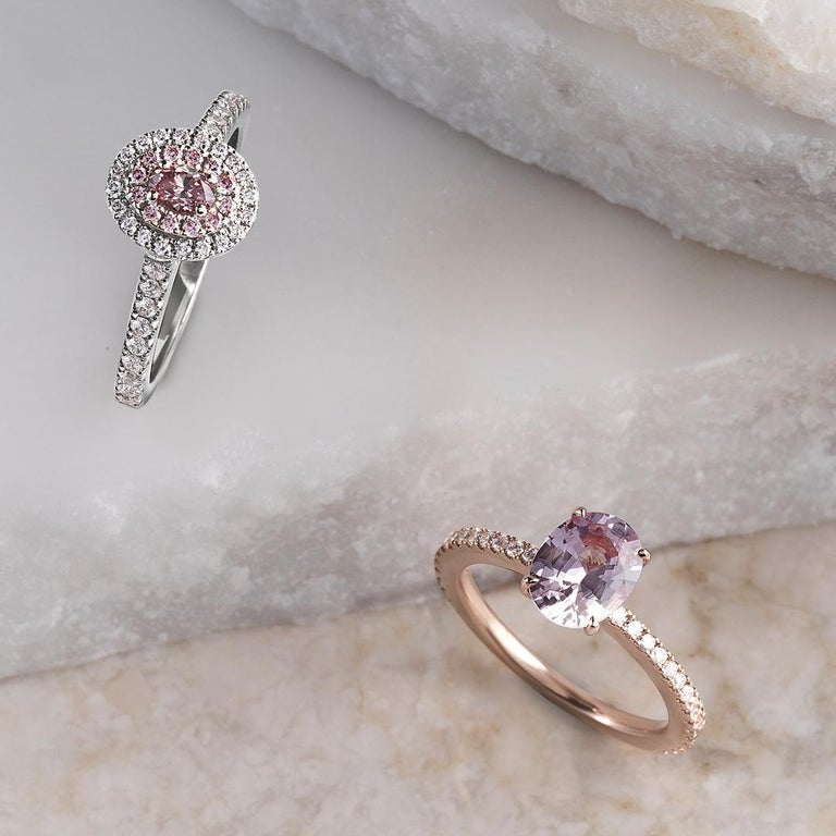 This divine Matthew Ely ring features a 0.20ct Argyle Pink Diamond 6PR (clarity VS1) at its centre with a first halo of 12 Pink Diamonds FP (clarity VS1 weighing 0.09ct), a second halo and a band of 39 White Diamonds (colour F / SI1 weighing