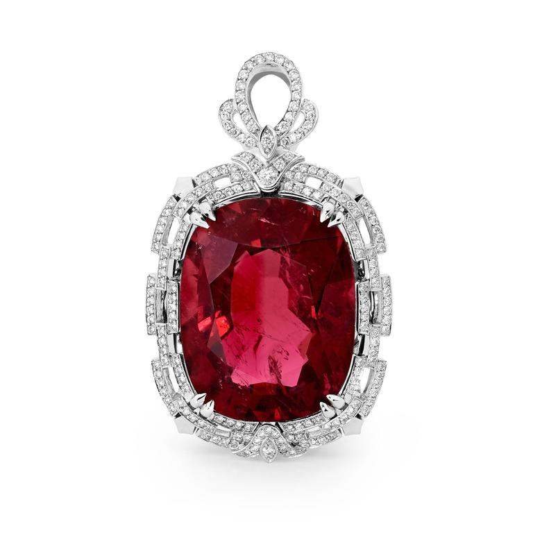 Our Joyau Rouge features a stunning 64.53ct Rubellite Tourmaline at its heart, surrounded with over 1.64cts of bright white diamonds with a VS/SI clarity in an 18ct white gold Art Deco inspired setting. The pendant is suspended on a three layer