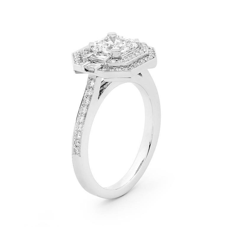 This stunning engagement ring features a 1.31ct Asscher Cut Diamond (color F clarity SI1) encased between two halos of white Diamonds and finished with a Divine micro pave Diamond set platinum band (total weight 0,47ct color FG clarity VS). GIA:
