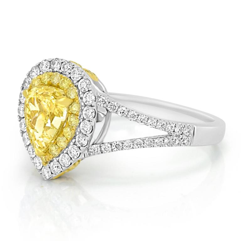 Natural Fancy Yellow Pearshape  1.09 Carat encircled in Double Halo of Natural Fancy Yellow Round Diamonds 0.22 Carat and White Diamond Round 0.53 Carat in 18K White and Yellow Gold Ring.  Total Diamond Weight : 1.84 Carat