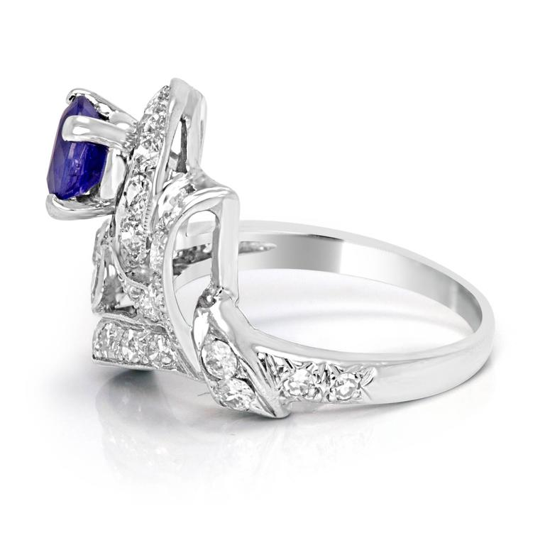 1.10 Carat Heated Blue Sapphire round with white diamond round approximate 0.45 carat total weight in Platinum Art Deco  Ring.