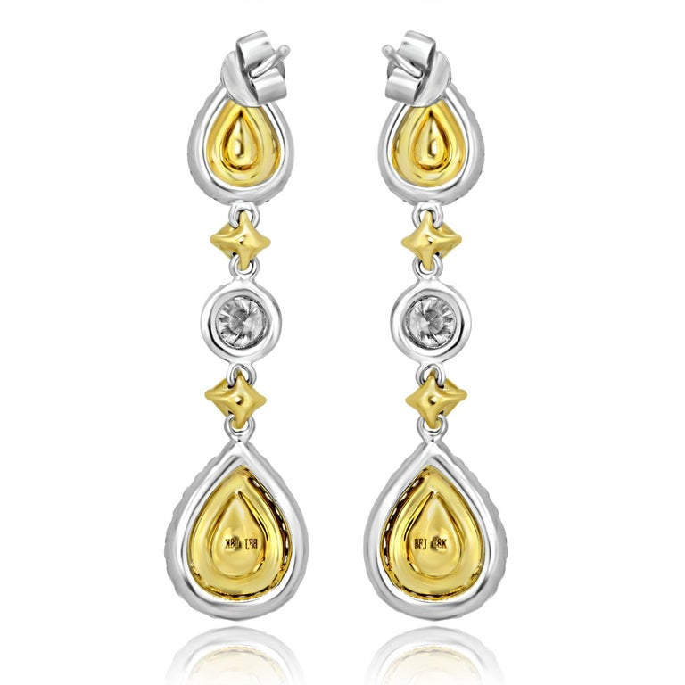 Contemporary Natural Fancy Yellow Diamond Double Halo Two Color Gold Dangle Earring For Sale