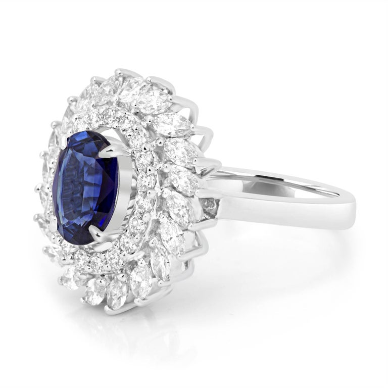 GIA Certified Stunning Blue Sapphire 1.50 Carat Encircled in a Halo of White Diamond Rounds VS Quality and White Diamond Marquise VS Quality  1.10 Carat in 14K White Gold Stylish Fashion Cocktail Ring.  Style available in different price ranges.