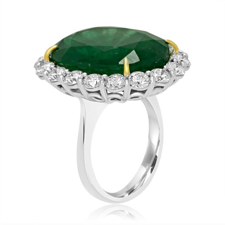 GIA Certified Zambian Emerald Oval 19.78 Carat Encircled in Halo of White Diamond Round 2.37 Carat In 18K White and Yellow Gold always in style classic Lady Diana Ring.  MADE IN USA Total stones Weight 22.15 Carats.