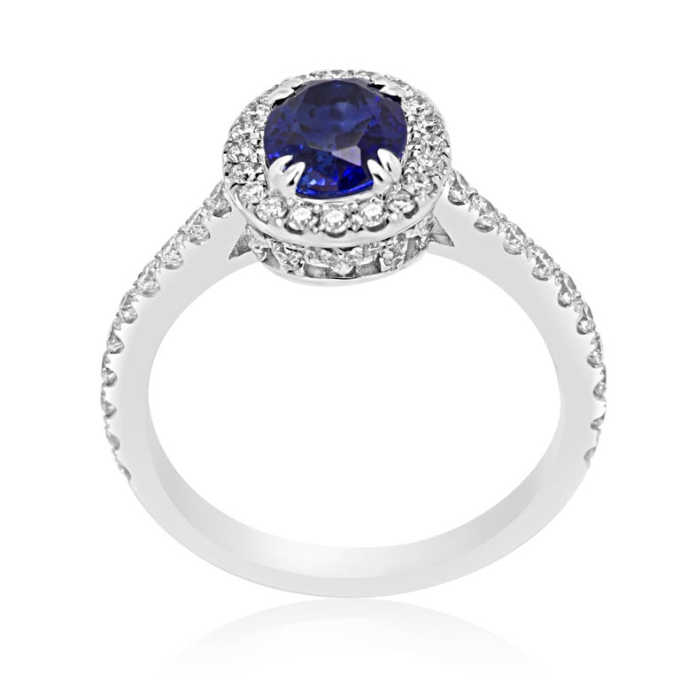 Modern Blue Sapphire Oval Single Halo Diamond Gold Ring For Sale