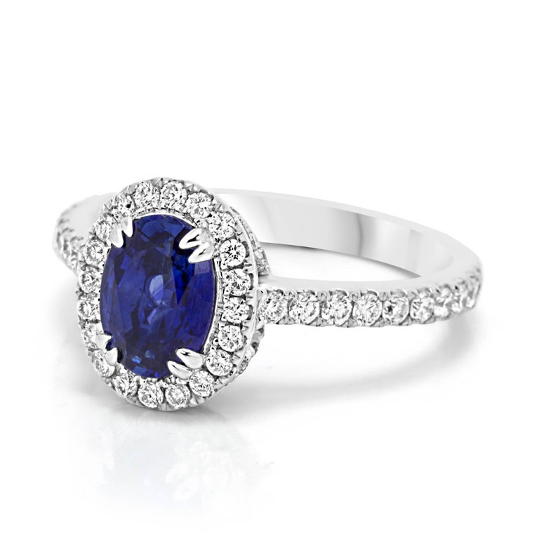 Gorgeous Natural Blue Sapphire Oval 1.32 Carat Encircled in a single Halo of White Diamond 0.65 Carat in 14K White Gold Classic and Intricate Bridal as well as Fashion Ring.   Total Stone Weight 1.87 Carat