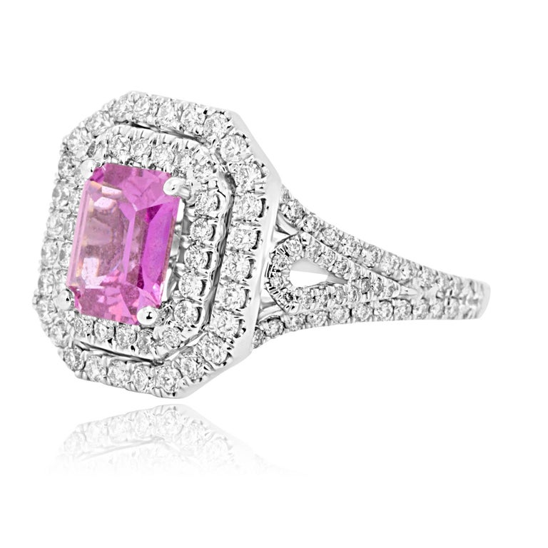 Beautiful GIA Certified No Heat Emerald Cut Pink Sapphire 1.73 Carat encircled in a double halo White Round Diamonds 1.02 Carat in 18K White Gold Bridal Fashion Ring.  MADE IN USA Total Stone Weight 2.75