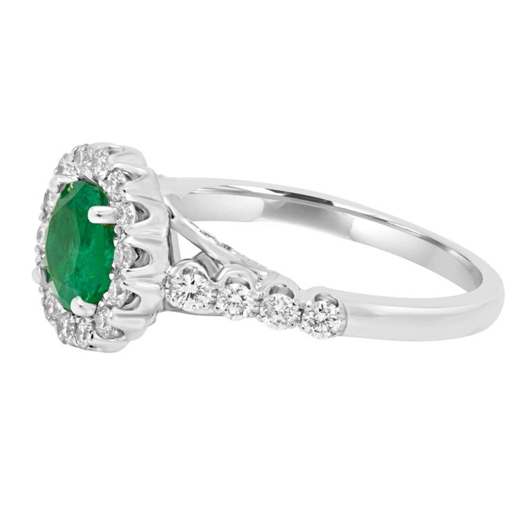 Emerald Round 1.08 Carat encircled in a halo white diamond rounds 0.75 Carat in 18K White Gold Ring.  MADE IN USA Total Stone Weight 1.83 Carat