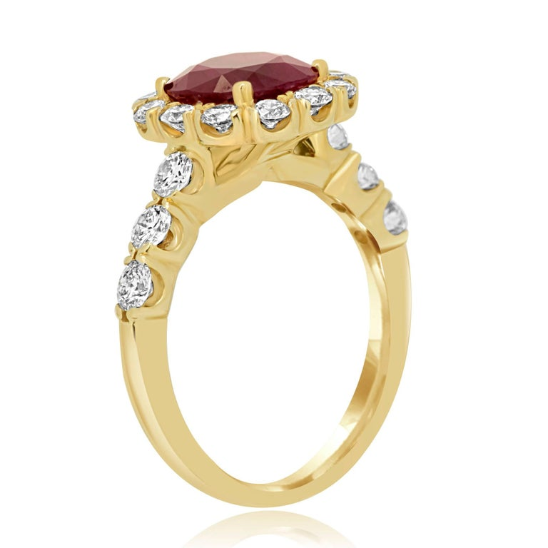 Contemporary GIA Certified Burma Ruby Cushion 2.33 Carat Diamond Halo Gold Bridal Ring For Sale