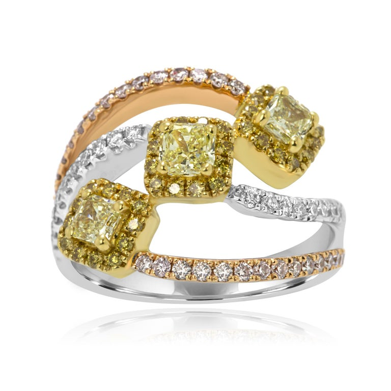 Stunning Three Stone Cocktail ring with 3 Natural Fancy Yellow Radiant Cut Diamonds 0.74 Carat Encircled in a Halo of Natural Fancy Yellow Round Diamonds 0.20 Carat with 2 Rows of Natural Pink Diamond Rounds 0.36 Carat on Side and One Row of White