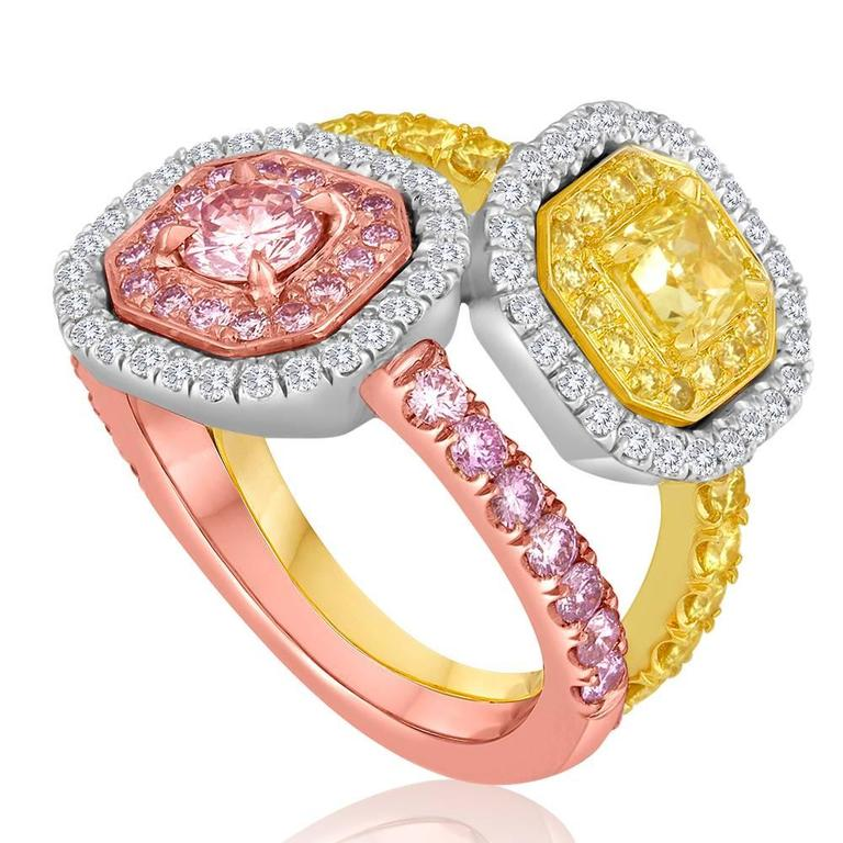 Stunning 0.36 Carat Center stone Natural Fancy Pink Diamond encircled in a halo of Natural Fancy Pink weighing 0.61 carat and white diamonds weighing 0.46 carat. 0.60 Carat Center stone Natural Fancy yellow diamond encircled in 0.59 Carat natural