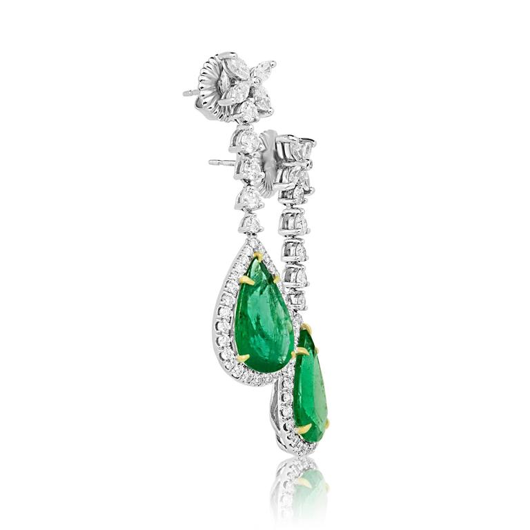 2 Pear Shape Emerald 9.02 Carat Encircled in Halo Of White Diamond 1.60 Carat and 8 Diamond Marquis 0.90 Carat in 18K White and Yellow Gold Dangle Earring.   MADE IN USA. Total Stone Weight 11.52 Carat