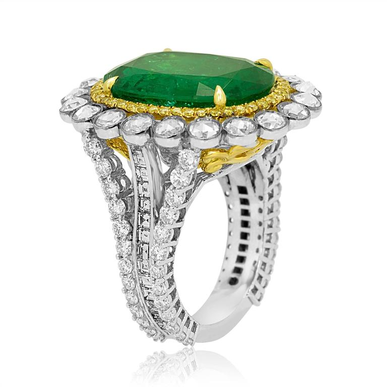 One of a kind GIA Certified Zambian Emerald oval 8.55 Carat encircled in a double Halo Natural fancy yellow rounds 0.34 Carat and white diamond rose cut round 1.50 carat, with three prong shank with white diamond round 1.19 carat and white diamond