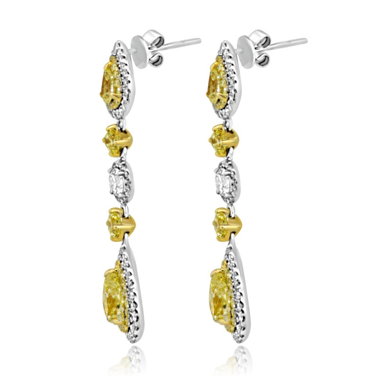 Natural Fancy Yellow Diamond Double Halo Two Color Gold Dangle Earring In New Condition For Sale In NEW YORK, NY