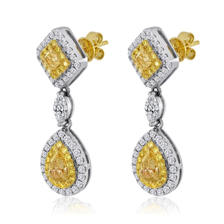 2 Pear Shape Natural Fancy Yellow Diamond  1.06 Carat, 2 Natural Fancy Yellow Radiant Cut Diamond 0.51 Carat encircled in double halo of natural fancy yellow round diamonds 0.60 Carat and White Diamond Rounds 0.89 with 2 White Diamond Marquis  0.49