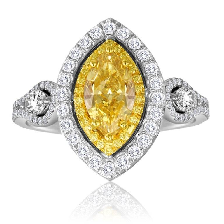 GIA Certified Vivid Yellow looking Fancy Intense Yellow Marquise 1.10 Carat encircled in Double Halo of Natural Fancy Yellow Round Diamonds 0.23 Carat and White Round Diamonds 0.75 Carat  flanked by 2 White Diamond Marquise on the side 0.31 Carat in