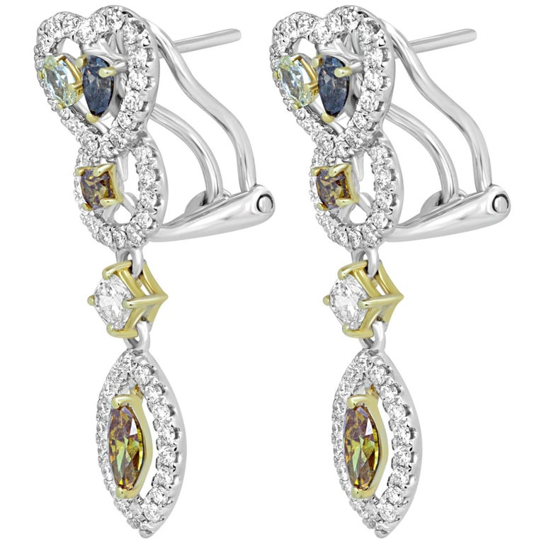 Beautiful 10 Multicolored and Mix Shapes Natural Fancy color Diamonds 1.31 Carat Encircled in a single Halo of White Round Diamonds 0.73 Carat in 18K White and Yellow Gold One of a Kind Earring.  Total Diamond Weight 2.04 Carat