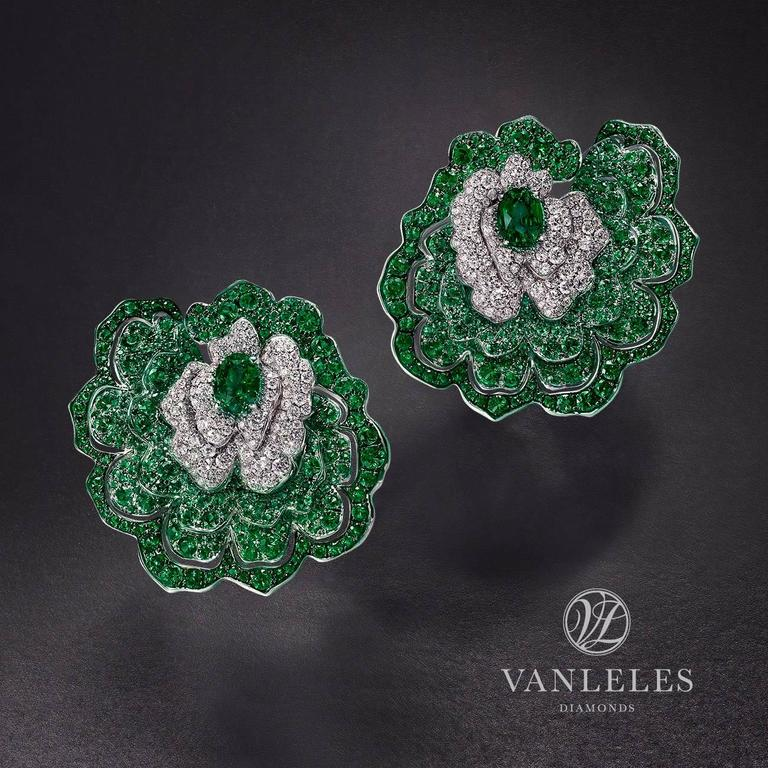 Contemporary Earrings crafted in 18K White Gold, White Diamonds and Emeralds For Sale