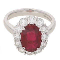 Oval Ruby Diamond Cluster Engagement Ring