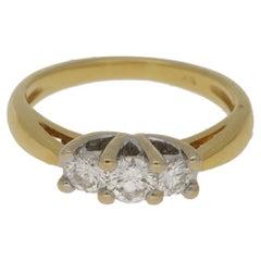 18 Karat Gold Three-Stone Diamond Engagement Ring