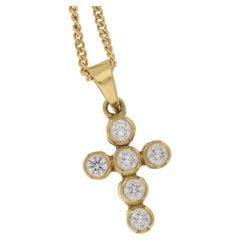 18 Karat Gold Diamond Cross Pendant