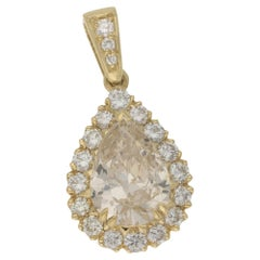 6.55 Carat Pear Fancy Yellow Diamond Cluster Pendant with Sixteen Halo Diamonds