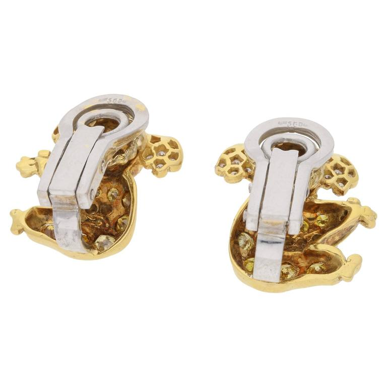 A rare and fun pair of yellow and white diamond koala bear clip earrings set in 18ct white and yellow gold. With cabochon onyx eyes and nose contrasting brightly against the pave set yellow diamonds set in 18ct yellow gold and pave set white
