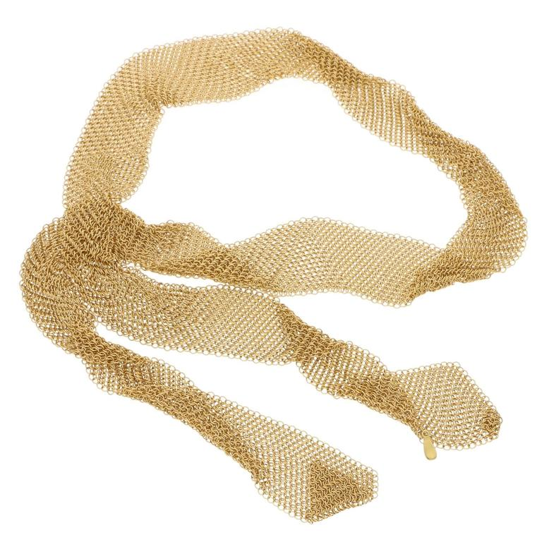 A truly exceptional Tiffany & Co. 18 carat yellow gold mesh necklace by Elsa Peretti. The exquisite necklace is intricately designed in the form of a scarf which tapers diagonally at each end. This exceptional piece is extremely flexible and can