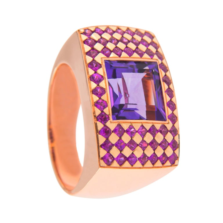 Jona design collection, hand crafted in Italy, 18 karat rose gold ring band, centering a square cut amethyst weighing 4.39 carats, surrounded by 52 pink sapphires weighing 1.18 carats.  Ring size US 6- EU 12, can be sized to any