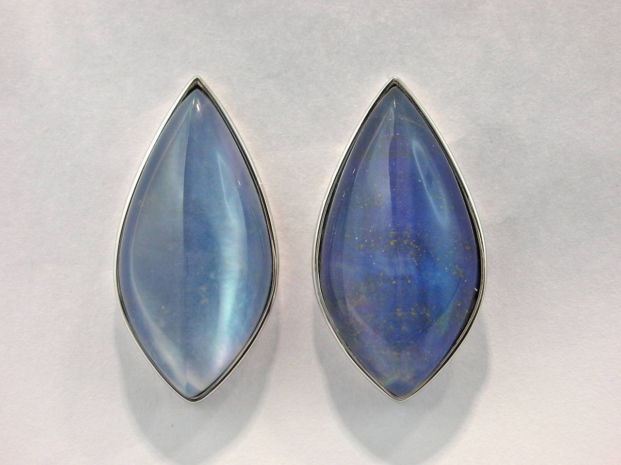 Jona design collection, hand crafted in Italy, 18 Karat white gold earrings set with a cabochon cut Quartz over Lapis Lazuli and Mother of Pearl, weighing 54.28 carats. Clips can be mounted upon request. All Jona jewelry is new and has never been