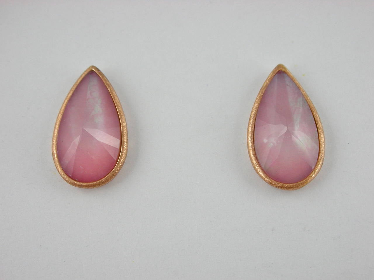 Jona design collection, hand crafted in Italy, 18 Karat rose gold stud earrings set with a crazy cut Quartz over Pink Opal and Mother of Pearl, weighing 5.6 carats. Clips can be mounted upon request. All Jona jewelry is new and has never been