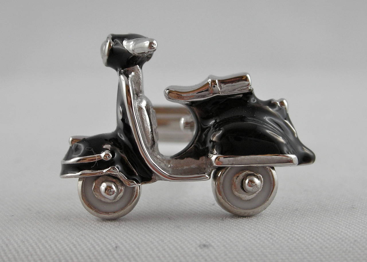Sterling silver scooter cufflinks by Jona with rotating wheels and black enamel. All Jona jewelry is new and has never been previously owned or worn. Each item will arrive at your door beautifully gift wrapped in Jona boxes, put inside an elegant