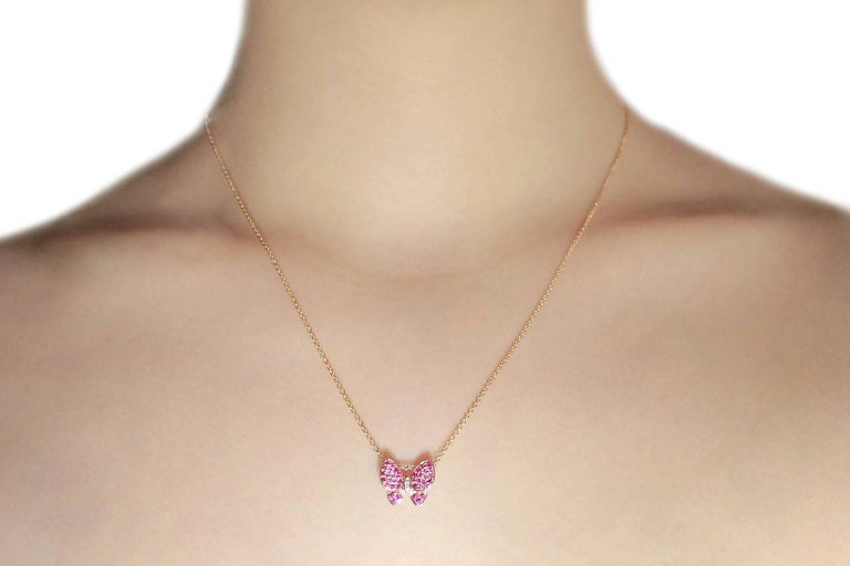 Jona design collection, hand crafted in Italy, butterfly pendant in 18 karat rose gold  set with 0.38 carats of pink sapphires and 0.01ct. of white diamonds  and mounted on a 18 karat rose gold chain, 17.71 inch long.  All Jona jewelry is new and