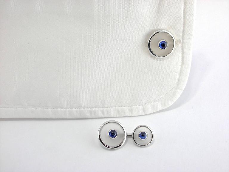 Jona design collection, hand crafted in Italy, 18 karat white gold cufflinks with rock crystal buttons centering blue cabochon sapphires. All Jona jewelry is new and has never been previously owned or worn. Each item will arrive at your door