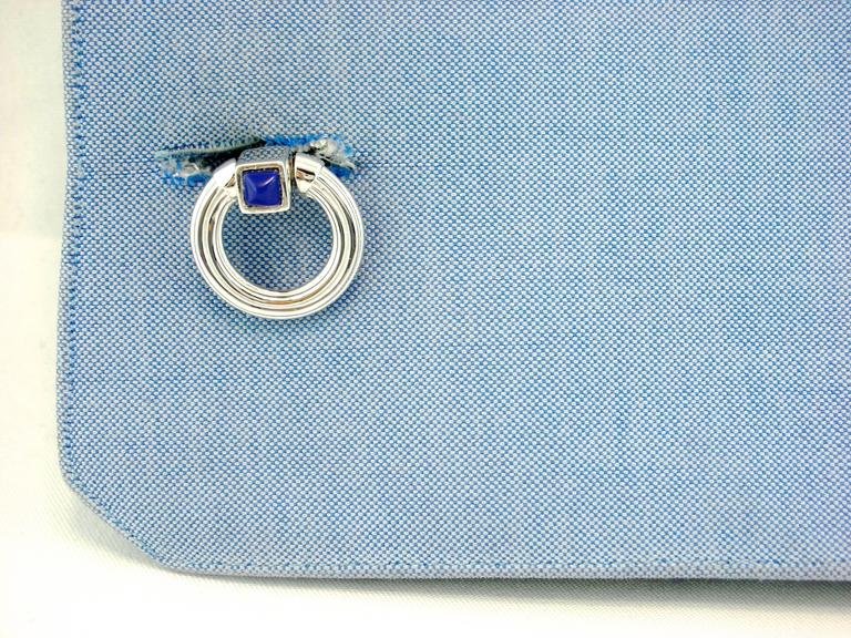 Jona design collection, hand crafted in Italy, rhodium plated sterling silver double ring folding cufflinks with Lapis cabochons. Marked JONA 925. These links push through the shirt cuff and fold down either side to keep them locked in tightly.  All