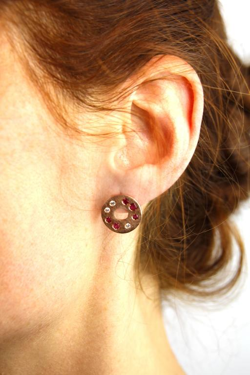 Jona design collection, hand crafted in Italy, 18 karat brushed rose gold stud earrings set with 6 brilliant cut white diamonds (0.19 carats) and 10 rubies (0.71carats). All Jona jewelry is new and has never been previously owned or worn. Each item