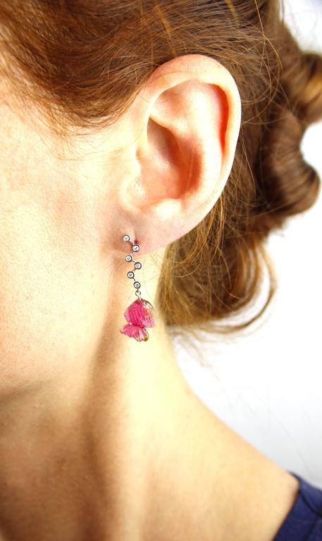 Jona design collection, hand crafted in Italy, 18 karat white gold dangle earrings, consisting of 2 fish-carved pink tourmalines, hanging from 0.13 carats of white diamond bubbles.  All Jona jewelry is new and has never been previously owned or