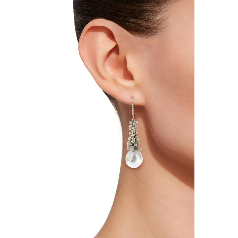 Jona one-of-a-kind design collection, hand crafted in Italy, 18 karat white gold dangle earrings, showcasing two natural light grey Tahiti baroque pearls, suspended from 13.30 carats of briolette cut ice diamonds and 0.10 carats of white diamonds.