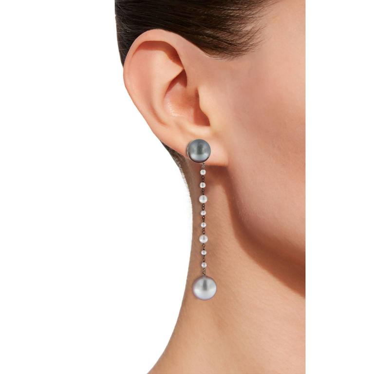 Jona design collection, hand crafted in Italy, 18 karat white gold dangle pearl earrings, showcasing two natural grey Tahiti pearls, two south sea white pearls and smaller white natural pearls.  The grey pearls may be worn separately, as stud