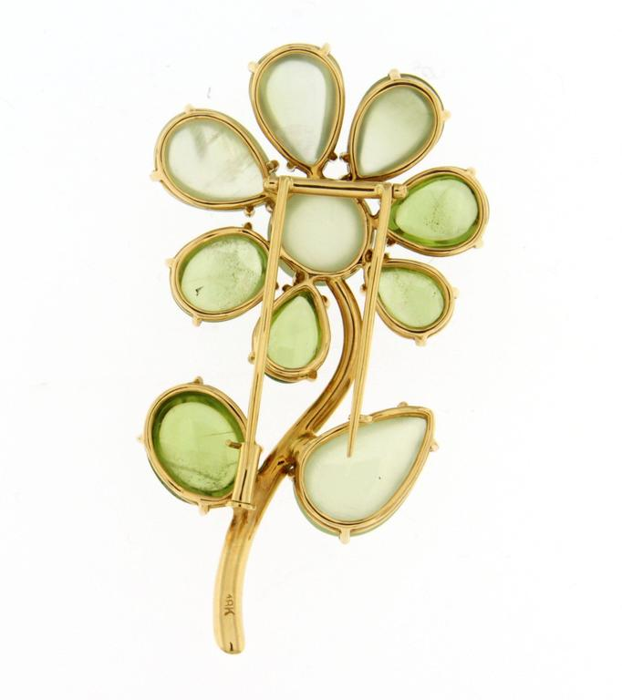 Jona design collection, hand crafted in Italy, 18 karat yellow gold flower brooch, showcasing 31.77 total carats of cabochon peridots and prehnites, enriched with a white diamond at the stem base.   All Jona jewelry is new and has never been