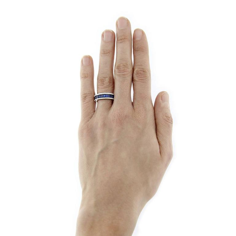 Jona design collection, 18 karat white gold band ring, set with a row of baguette cut blue sapphires weighing 1.56 carats framed by two rows of white diamonds weighting 0.26 carats.  US size 6.9. Can be sized to any specification.    All Jona