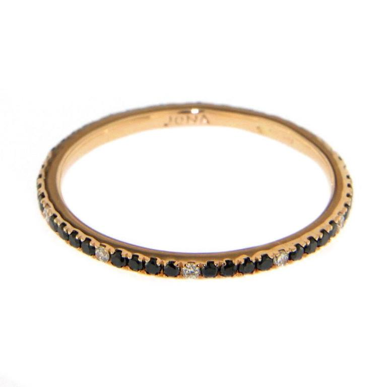 Jona design collection, hand crafted in Italy, 18 karat rose gold ring, set with 0.27 carats of black diamonds and 0.05 carats of white diamonds.  Ring size US. 6.2, can be sized to any specification.   All Jona jewelry is new and has never been